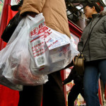 Shoppers carry their shopping with free supermarket plastic shopping bags in Beijing, 09 January 2008. Consumers will have to pay for plastic shopping bags at supermarkets and other retail stores in China from June 1 as the nation steps up efforts to fight plastic pollution, the government has ordered. AFP PHOTO/TEH ENG KOON